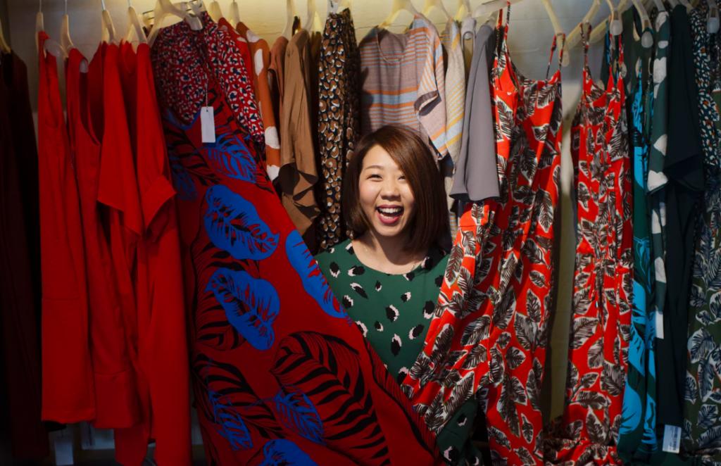 Female shopper in clothing store