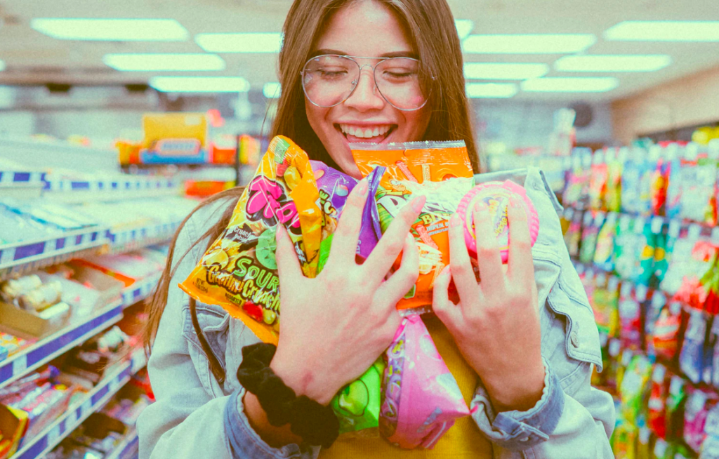 Woman holding bags of candies